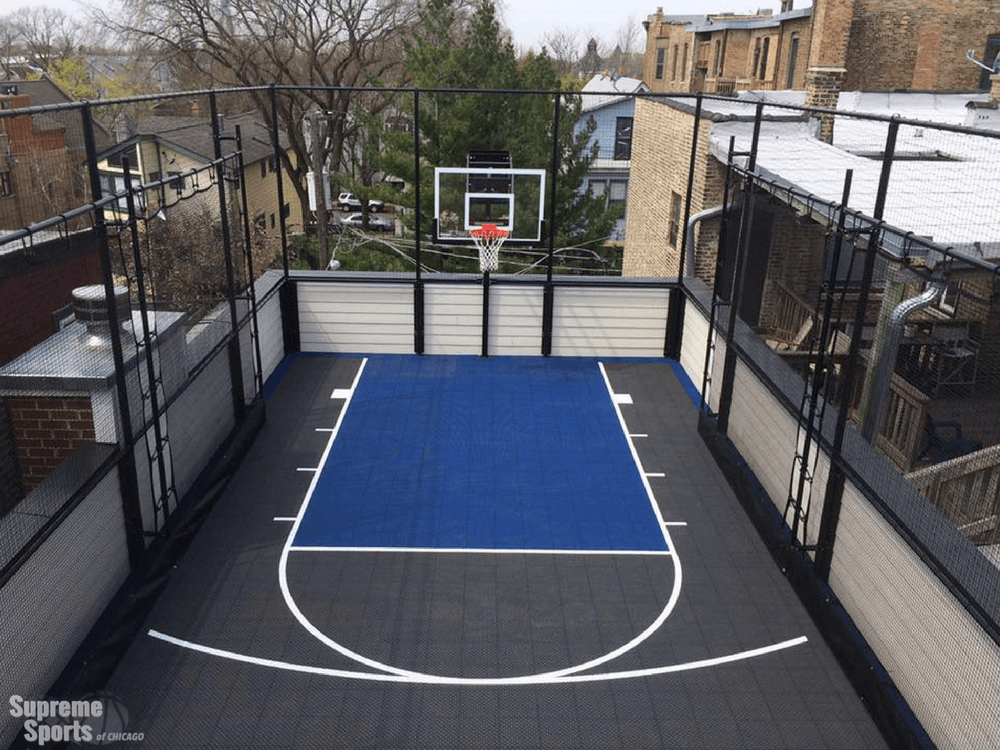 Gray and blue rooftop basketball court in Chicago