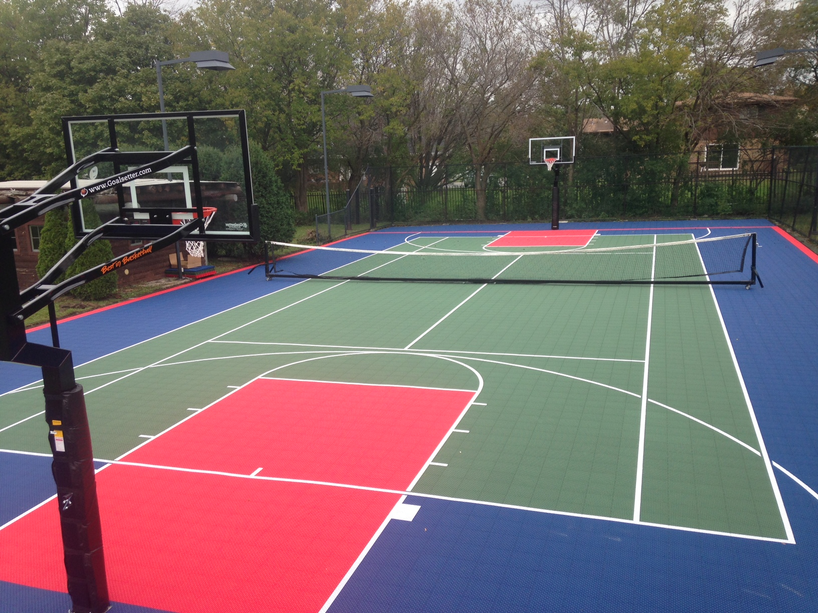 Backyard basketball court installation in chicago il for How to build a sport court